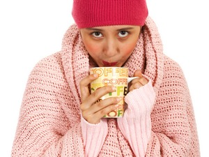 Girl With Fever Drinking A Cup Of Coffee To Warm Herself